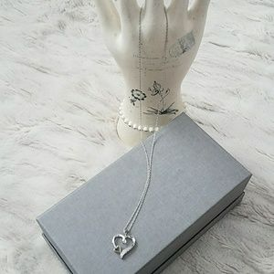 Double heart necklace with diamonds